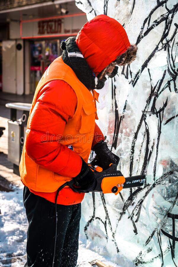 HARBIN, CHINA - DEC 30, 2018 : Ice sculptures, The workers are carve ice into various shape, located in Zhongyang Street Central. Street at Harbin City stock photography