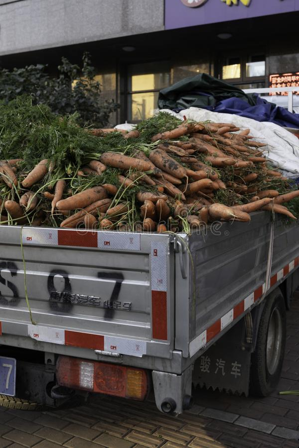 Harbin farmers market Carrots and the car stock images