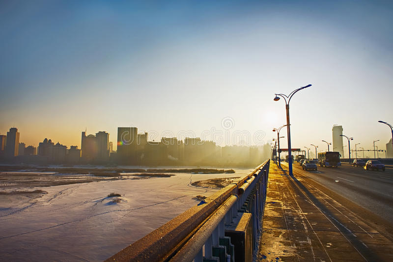 Harbin horisont i soluppgången arkivfoto