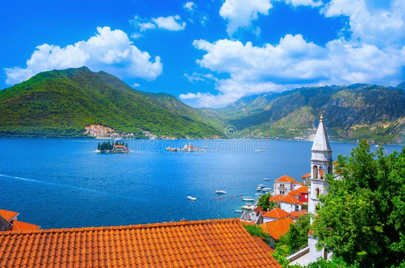 Harbor and ancient buildings in sunny day at Boka Kotor bay Boka Kotorska, Montenegro. Harbor and ancient buildings in sunny day at Boka Kotor bay Boka Kotorska stock images