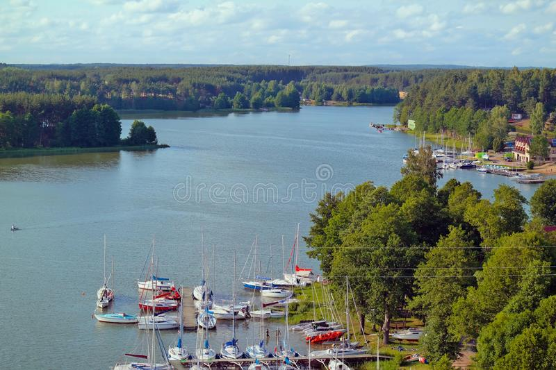Harbor on the blue lake stock image
