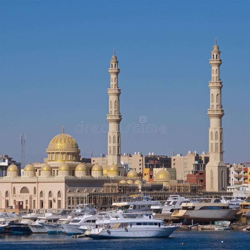 Harbor with boats and mosque at Hurghada on Red Sea in Egypt stock image