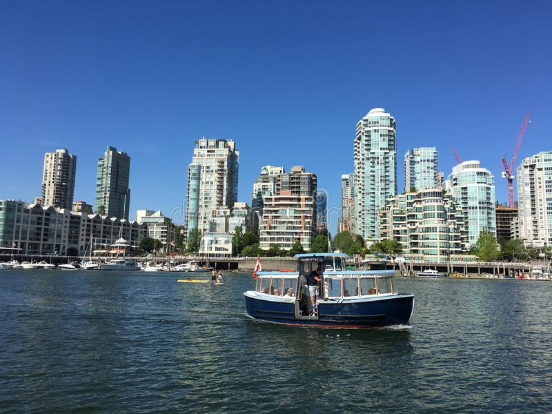 #002 Harbor boats and ships; Vancouver BC; Canada 150 years. Cute harbor boats and ships lines up under sunshine and float on water that is a beauty to celebrate royalty free stock image