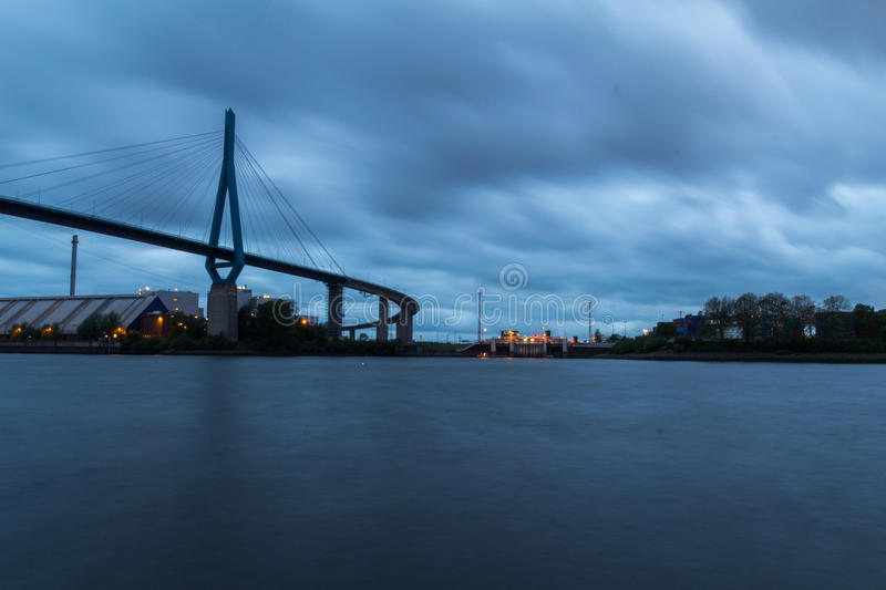 Harbor Bridge in Hamburg, Germany. Long Exposure of the Koehlbrand Bridge in the harbor of Hamburg, Germany under a dramatic sky stock photos