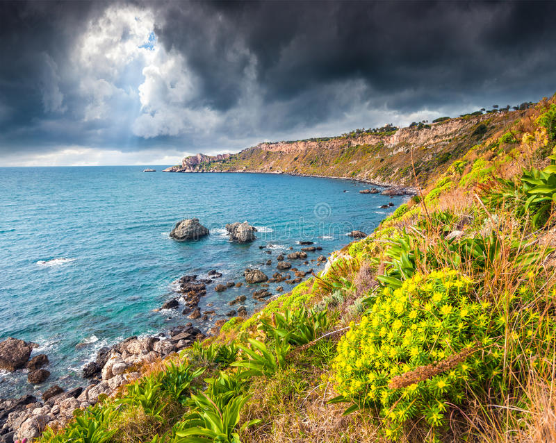 The harbor and cape Milazzo with nature reserve Piscina di Venere royalty free stock images
