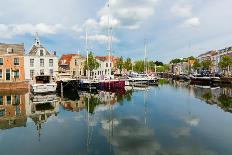 Harbor in the city of Goes, Zeeland, Netherlands. Goes, Netherlands - June 09, 2019: harbor in Goes, with unidentified people. The inner city of Goes is rich of stock photography
