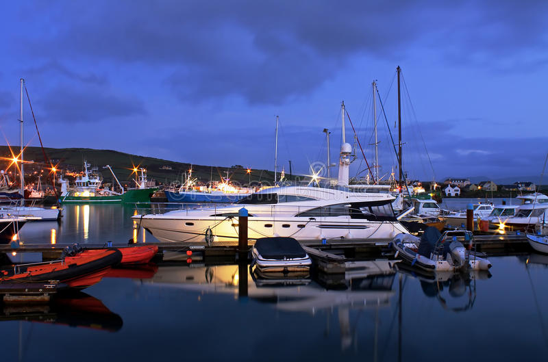 Harbor in Dingle at night. Boats in harbor - Dingle - Ireland - sunset stock photography