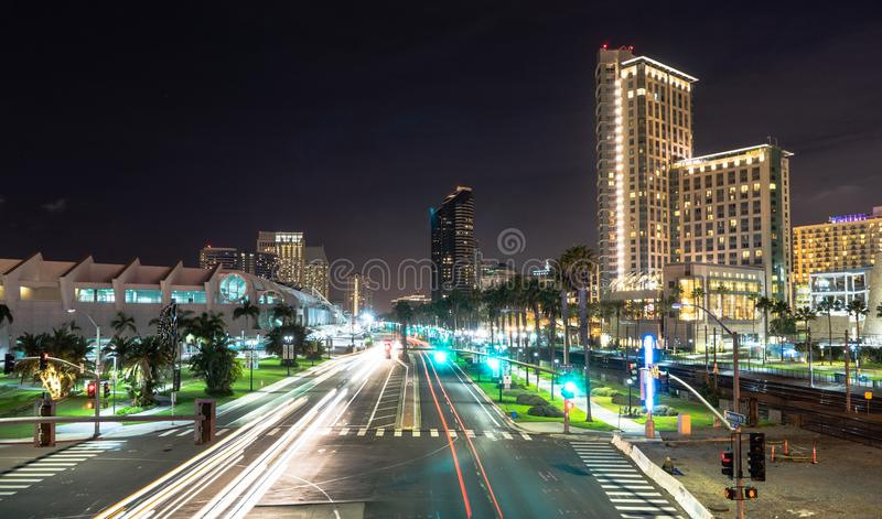 Harbor Drive Night time San Diego California Downtown City Skyline. The street lights a green as traffic creates light streaks on Harbor Avenue in San Diego stock photo