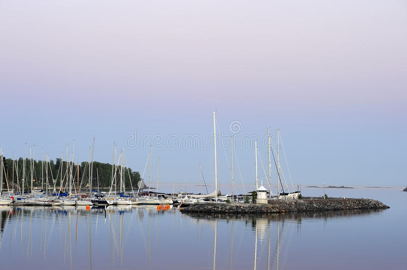 Harbor in dusk royalty free stock image