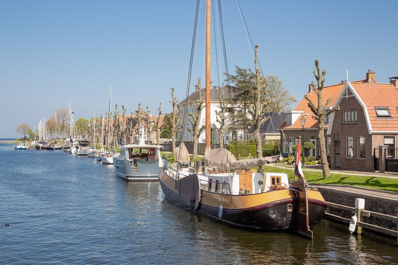 Harbor Dutch city Medemblik with historical wooden sailing ship royalty free stock photo