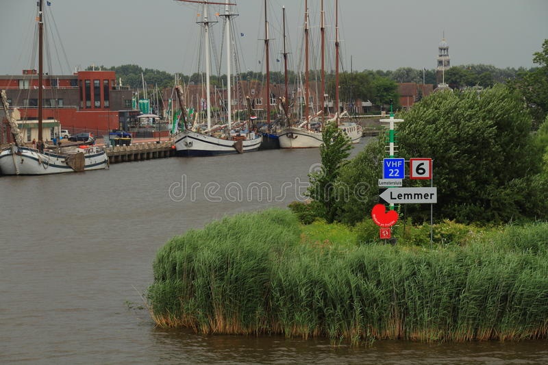 Harbor entrance Lemmer the Netherlands. Entrance to Lemmer Harbor from the Ijsselmeer - Holland stock images