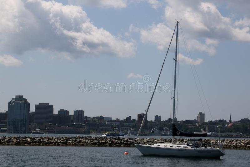 The sailboat against the background of Halifax. royalty free stock photo