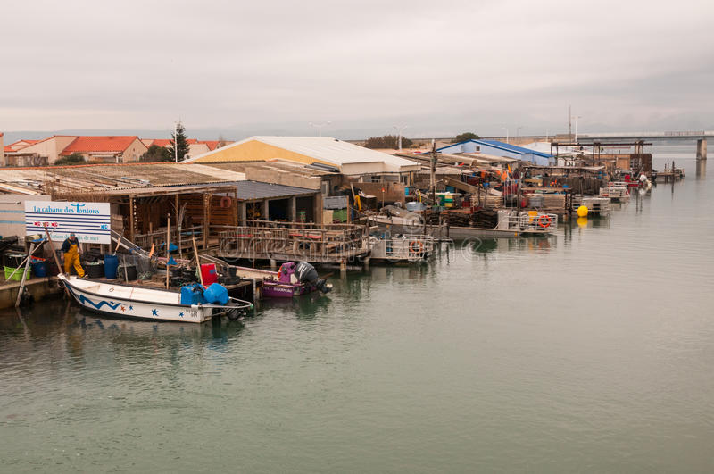 Harbor with fishing boats with oysters royalty free stock photos