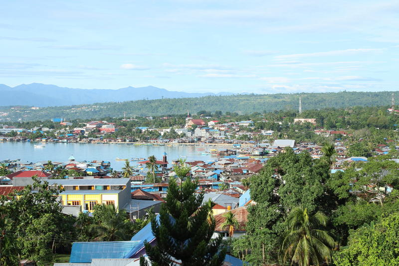 Harbor in Manokwari. View on small harbor with poor houses in Manokwari (Papua Barat, Indonesia royalty free stock photos