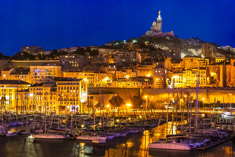 The harbor of Marseille at night stock photo