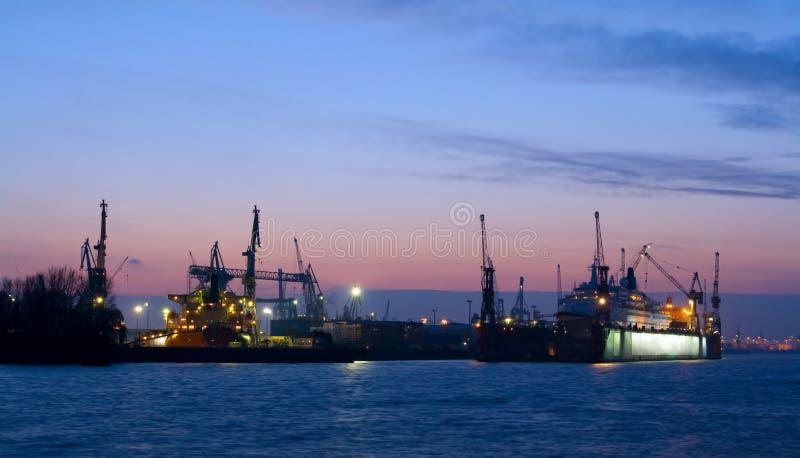 Harbor at nightfall stock photography