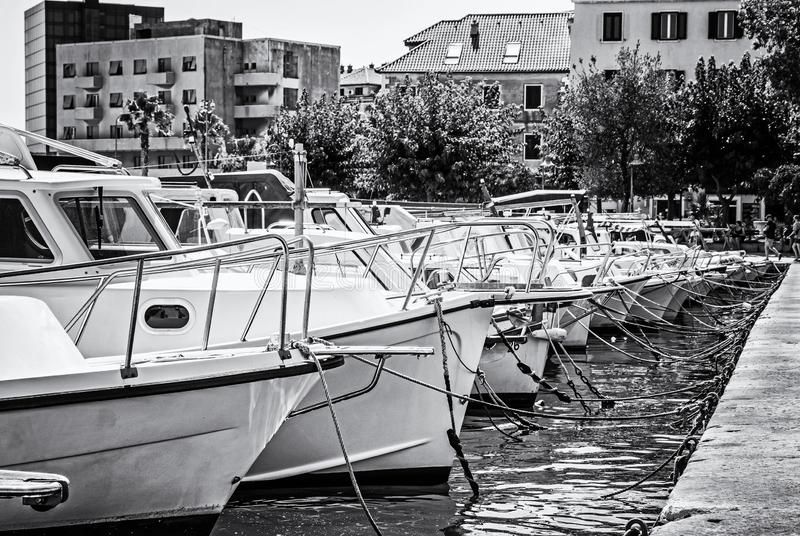 Harbor with passenger ships in Split, Croatia, colorless. Harbor with passenger ships in Split, Croatia. Travel destination. Summer vacation. Black and white stock photo