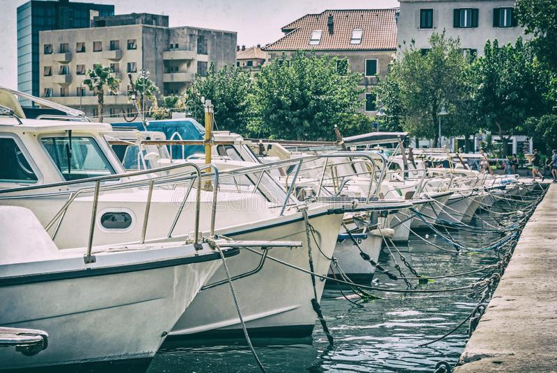Harbor with passenger ships in Split, analog filter. Harbor with passenger ships in Split, Croatia. Travel destination. Summer vacation. Analog photo filter with stock photos