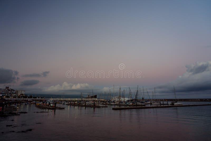 The harbor of ponta delgada art sunset royalty free stock photos