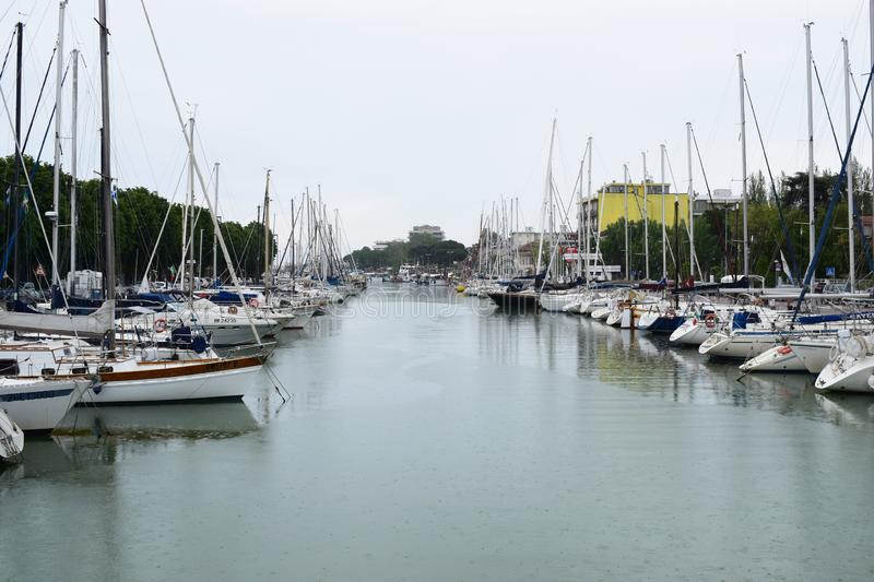 Harbor in Rimini, Italy. We see ships and boats royalty free stock photo