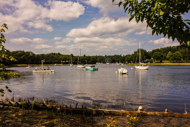 A Harbor in the Saco River. A peaceful scene in a natural harbor formed in a bend of the Saco River in Saco, Maine. The Saco River is a river in northeastern New stock images