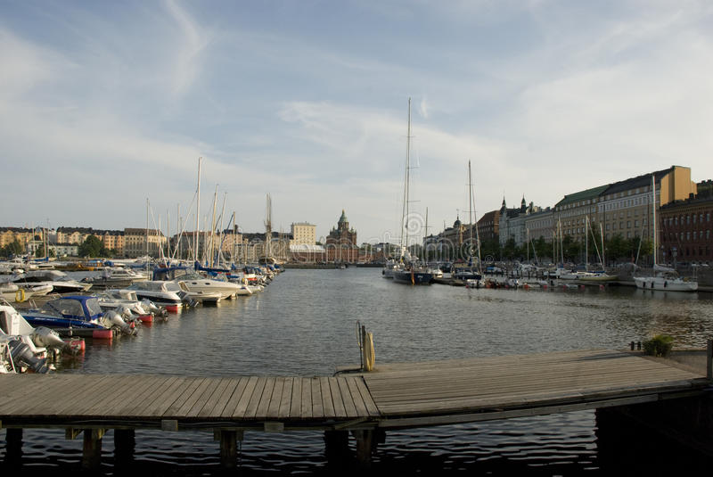 Harbor with sailing boats and Uspensky Cathedral in the back, Helsinki - Finland royalty free stock images