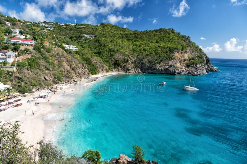 Harbor with sand beach, blue sea and mountain landscape in gustavia, st.barts. Summer vacation on tropical beach. Recreation, leis. Ure and relax concept royalty free stock photography