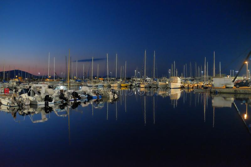 Harbor after sunset royalty free stock photography