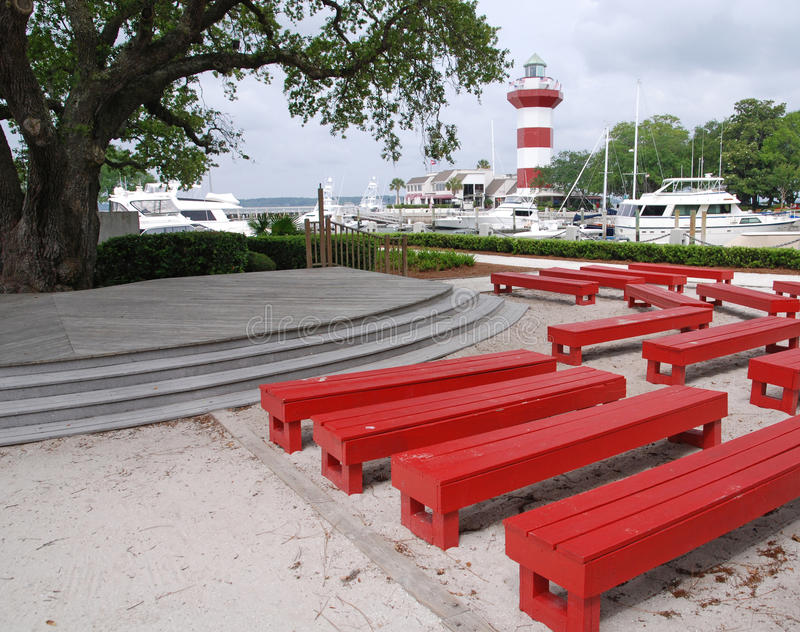 Harbor Town Lighthouse With Red Benches On Hilton Royalty Free Stock Image