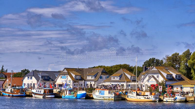 Harbor in Vitte with fishing boats on a sunny beautiful day, Hiddensee island, Baltic Sea, Germany. Clouds, europe, port, house, mecklenburg, pomerania, travel stock photography