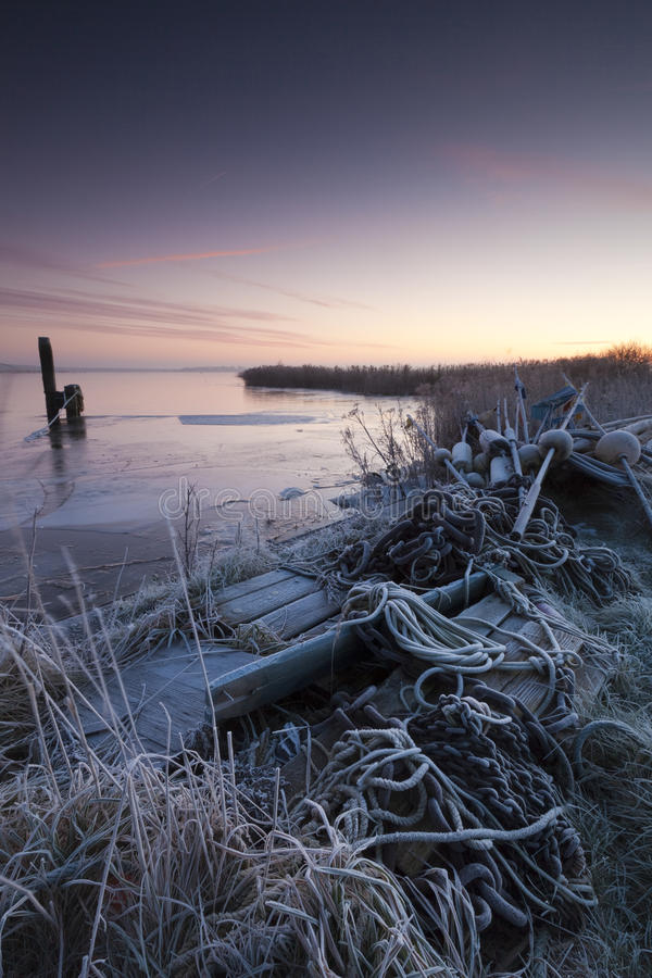 Harbor in winter and a beautiful sunrise royalty free stock photos