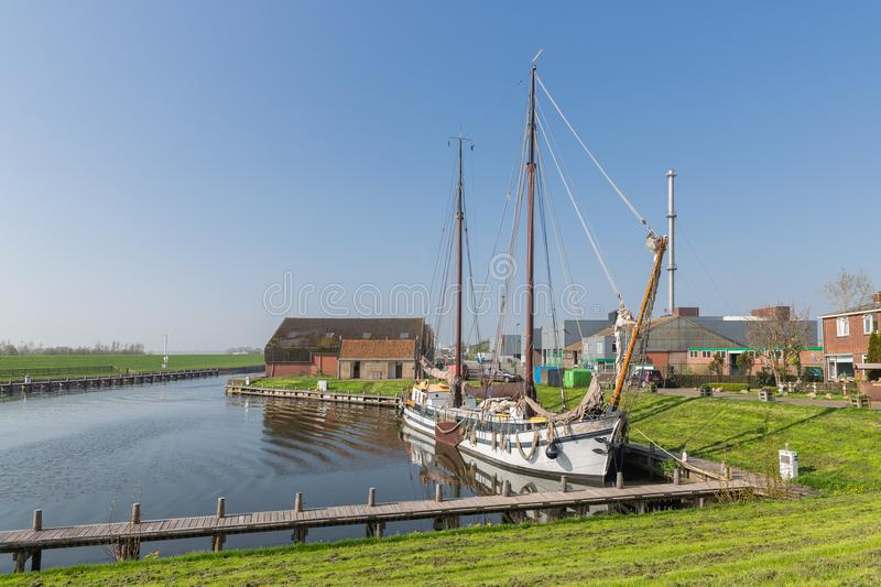 Harbor with wooden sailing vessel in Dutch fishing village Workum stock image