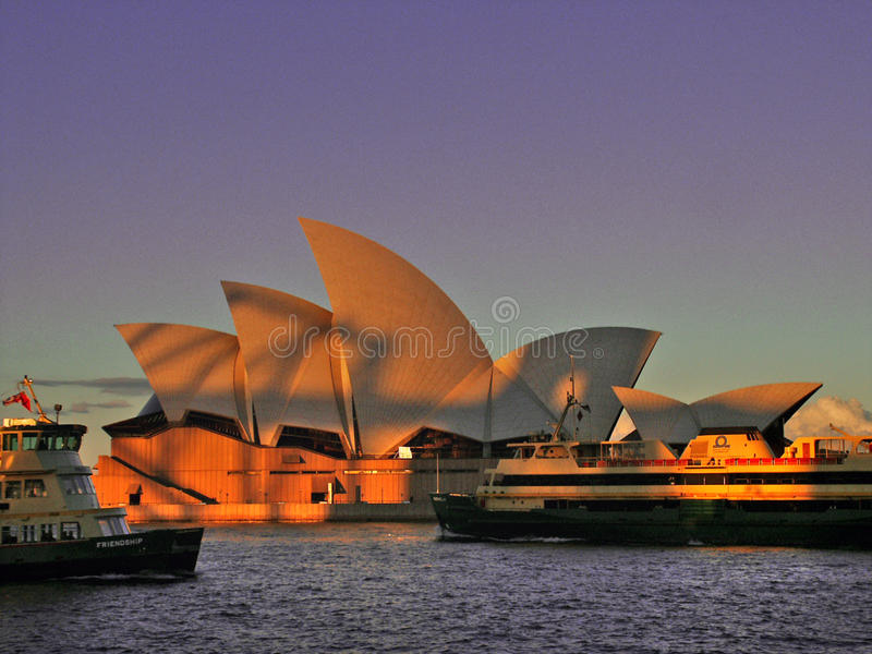 Harbour Bridge shadow on the Opera House. stock image