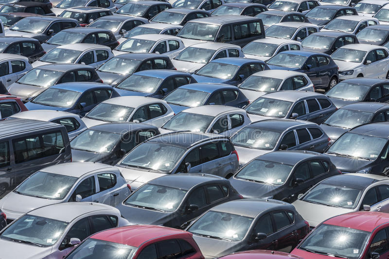 Harbour Car Park. New cars parked in a row in the port of Barcelona, Catalonia, Spain. They are waiting to be shipped royalty free stock images