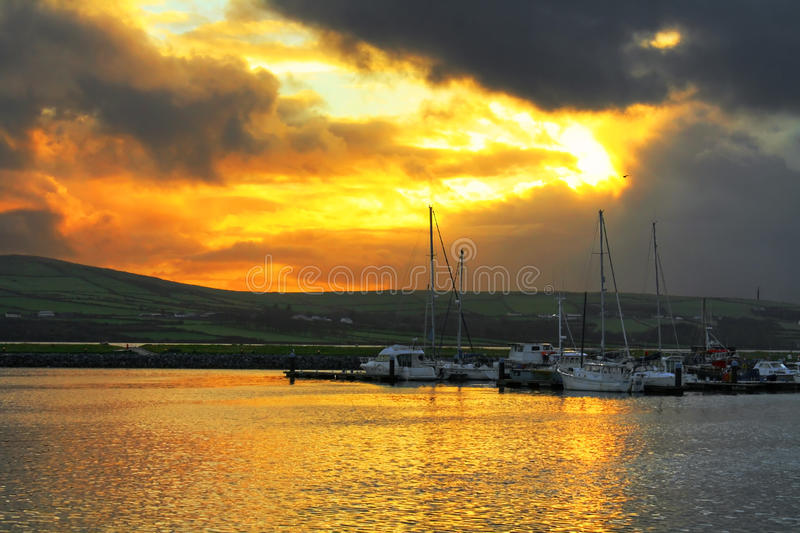 Harbour in Dingle at sunset. Yachts in harbour - Dingle - Ireland - sunset stock photography