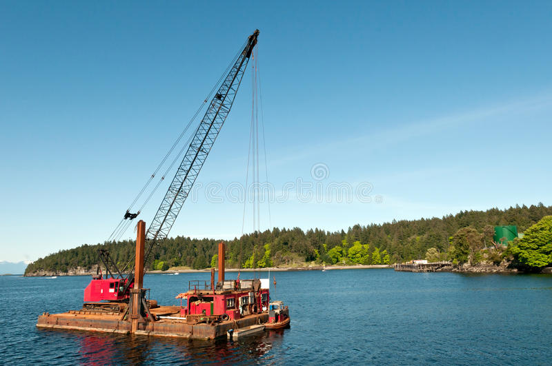 Harbour Dredge. A dredge in the harbour on the Pacific Coast royalty free stock photography