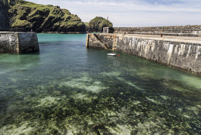 Harbour entrance at Mullion Cove in Cornwall in England stock image