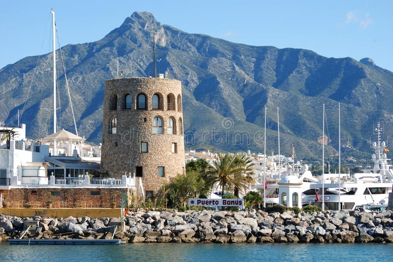 Harbour entrance, Puerto Banus, Marbella, Spain. Harbour entrance with the watchtower to the left and La Concha mountain to the rear, Puerto Banus, Marbella stock photo