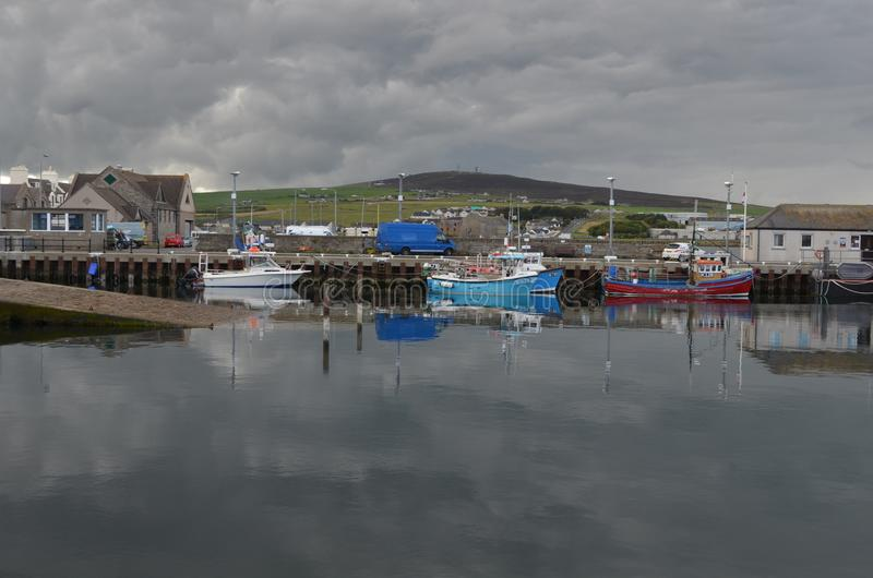 Harbour and inshore fishing fleet in Kirkwall, Mainland island, Orkney Scotland. Kirkwall is the largest settlement and capital of Orkney, an archipelago in the royalty free stock photography
