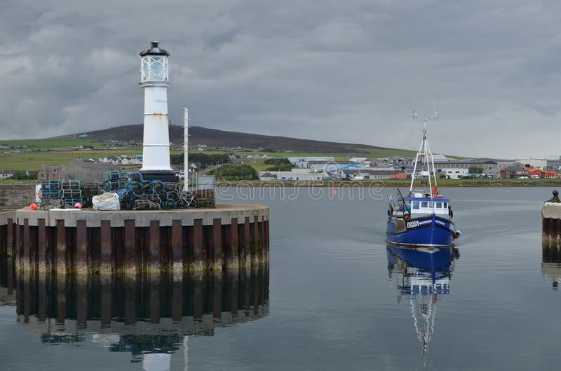 Harbour and inshore fishing fleet in Kirkwall, Mainland island, Orkney Scotland. Kirkwall is the largest settlement and capital of Orkney, an archipelago in the royalty free stock image