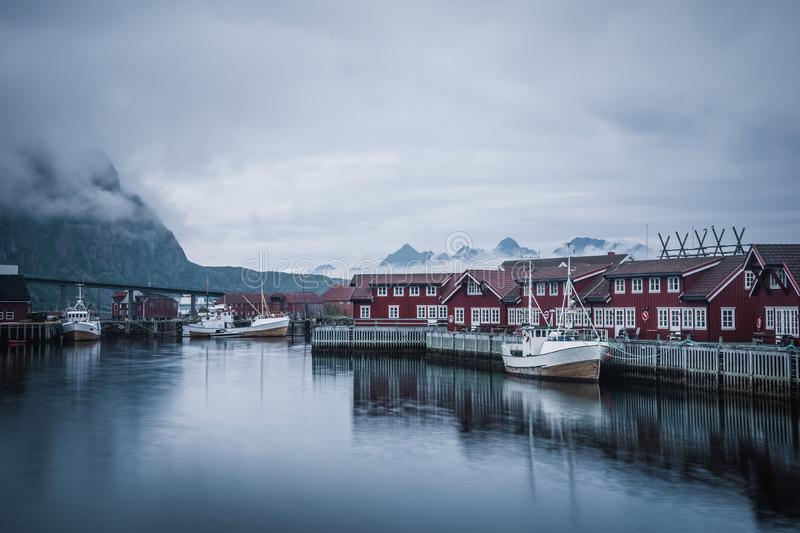 Harbour of the Lofoten village on the rainy day royalty free stock photography
