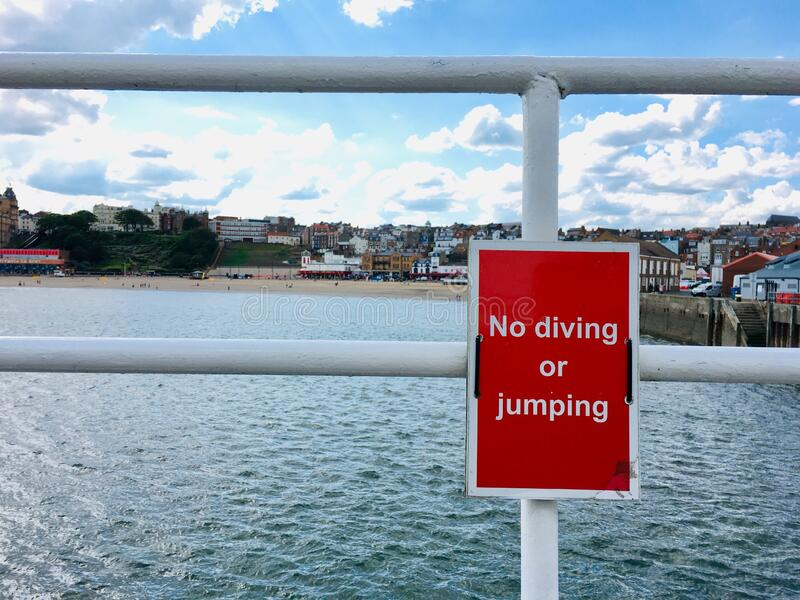 Scarborough, North Yorkshire, United Kingdom. The harbour and no diving sign at Scarborough, North Yorkshire, United Kingdom royalty free stock photos