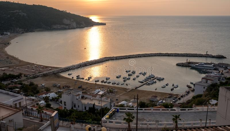 The harbour at Peschici, Puglia, Italy, photographed at sun down. Peschici is on the Gargano Peninsula. In the Foggia Province stock image