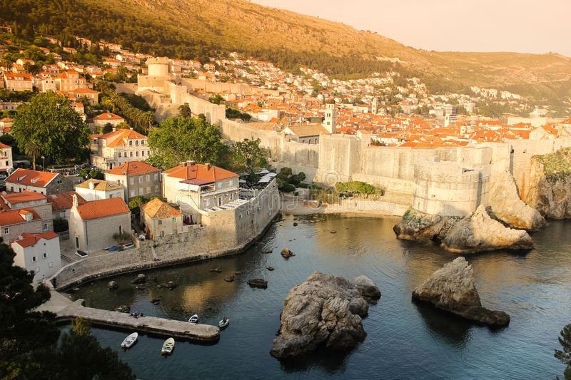 Harbour ramparts and citadel. Dubrovnik. Croatia. A little harbour, city walls and old town at sunset. Dubrovnik. Croatia stock photos