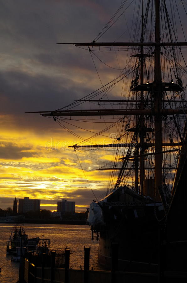 Sunset over HMS Warrior in Portsmouth Harbour royalty free stock photo