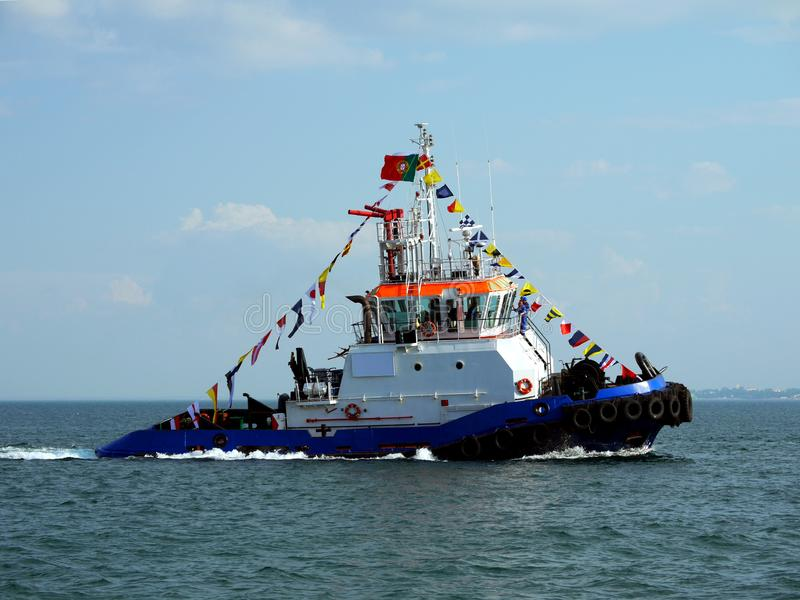 Harbour Tug on Maneuvers in Bay. royalty free stock photo