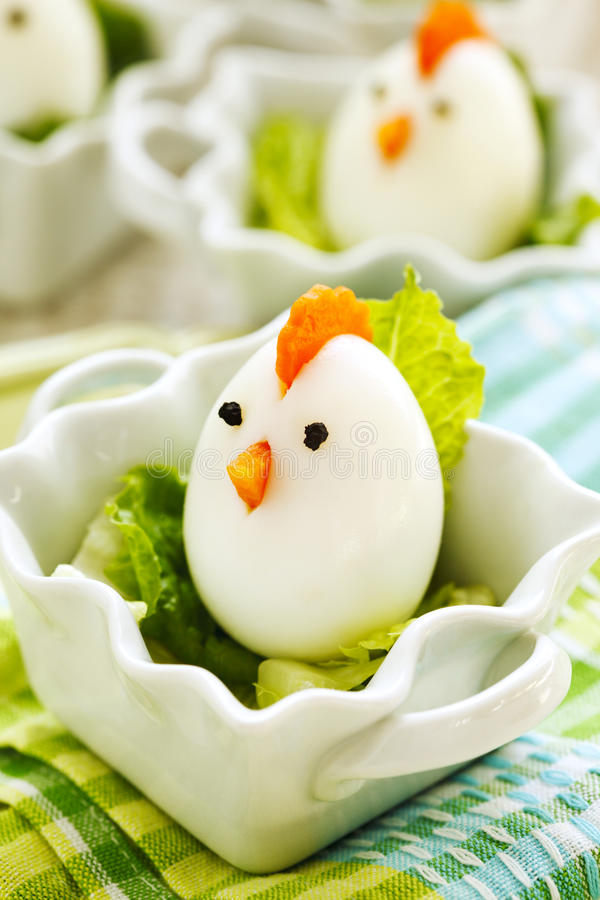 Hard boiled Chicken Egg Family. Easter food for kids. Hard boiled Chicken Egg Family served with lettuce. Easter food for kids royalty free stock photography