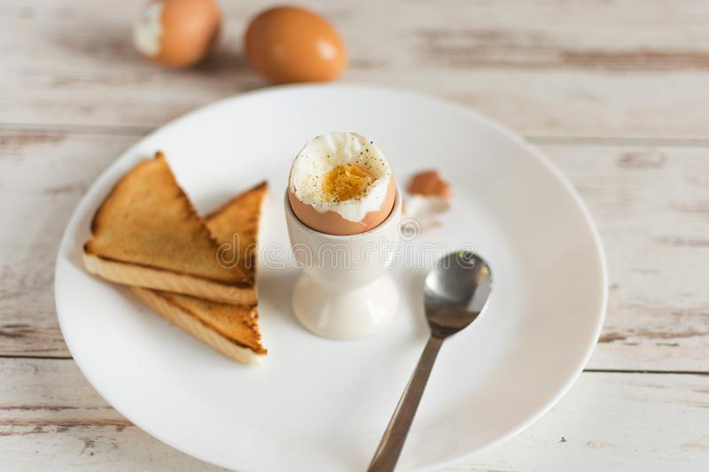 Hard boiled egg and bread sandwich with sprouted grain on a wooden table. Traditional food for healthy breakfast stock photo