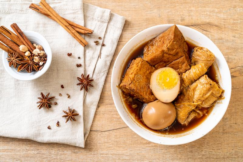 Hard-boiled egg in brown sauce or sweet gravy. Asian food royalty free stock photography