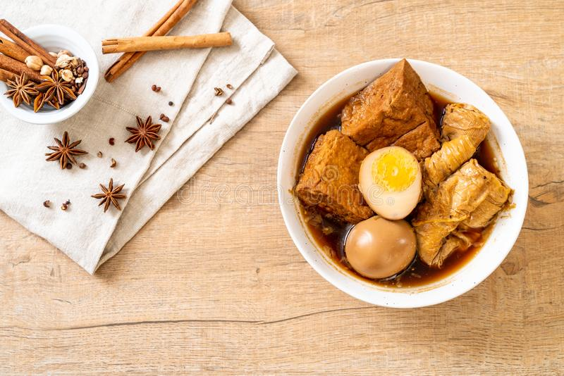 Hard-boiled egg in brown sauce or sweet gravy. Asian food royalty free stock image